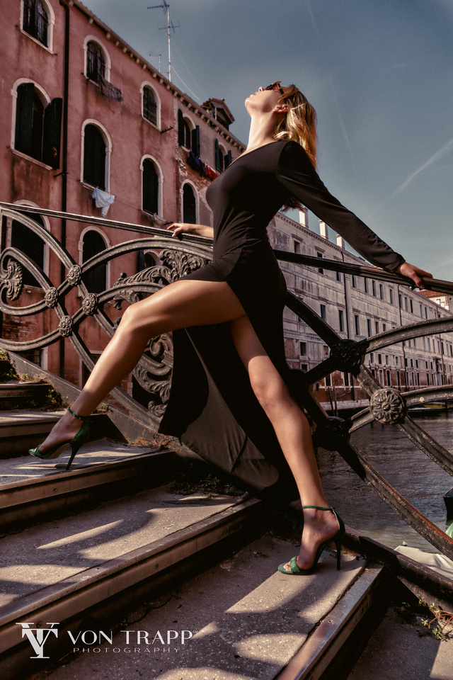 Sexy Fashion photo shoot in Venice Italy. Photograph of a beautiful woman on a Venice bridge.