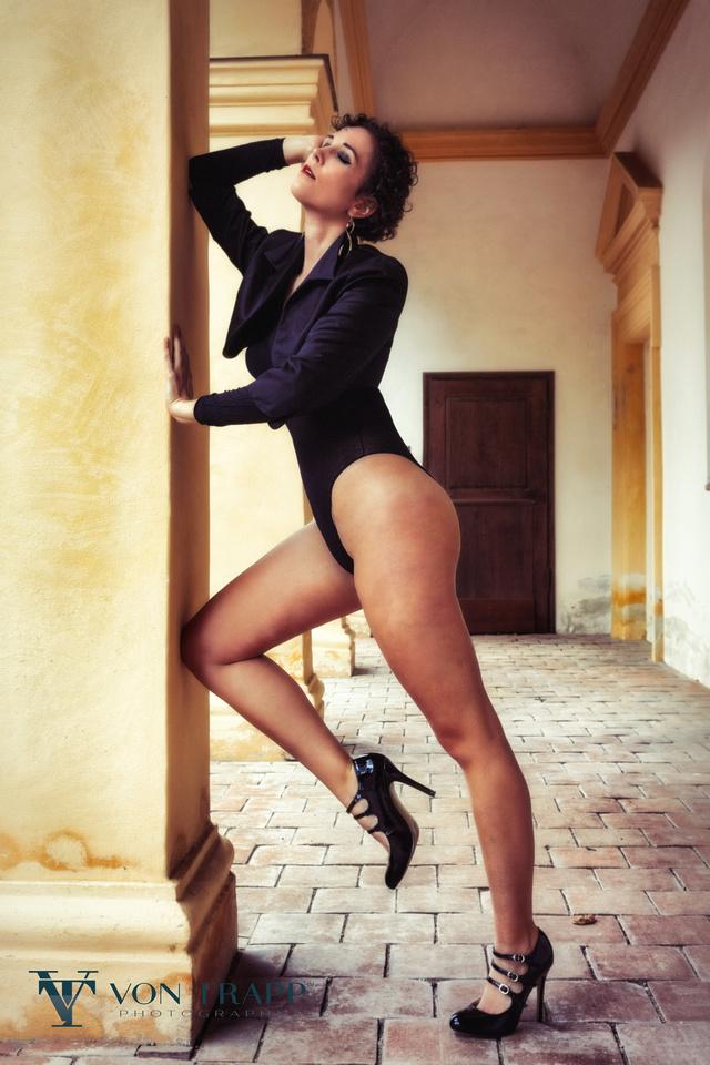 Austin-San Antonio Fashion Photographer. Sexy fashion editorial image of a leggy woman in Munich. Texas Photographer shoots in Germany.