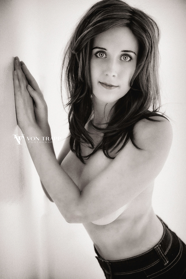 Sexy and emotive implied nude boudoir photograph in black and white.
