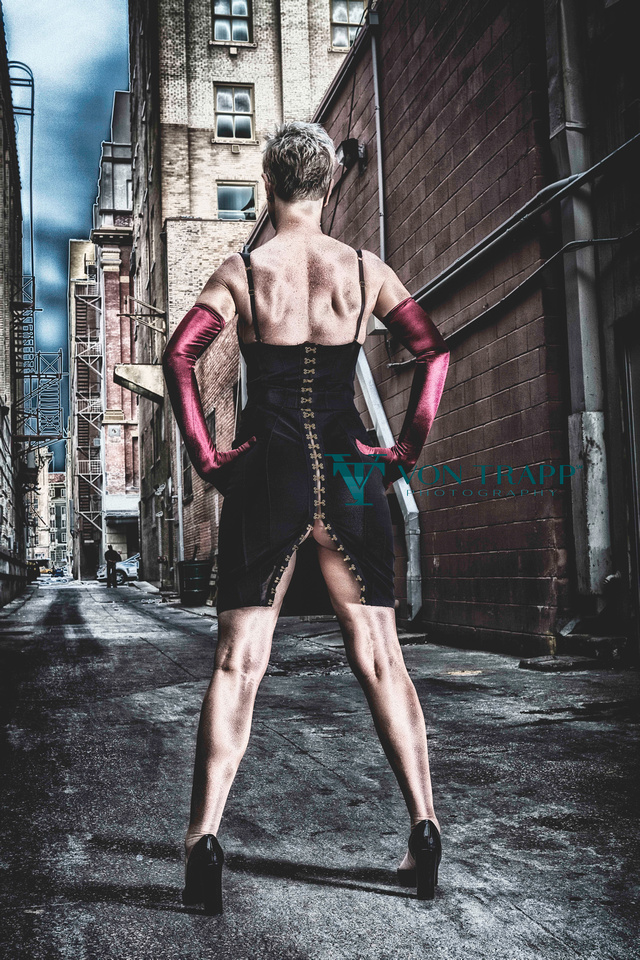 Edgy and sexy glamour photo of a woman in a Agent Provocateur dress in a San Antonio alley.