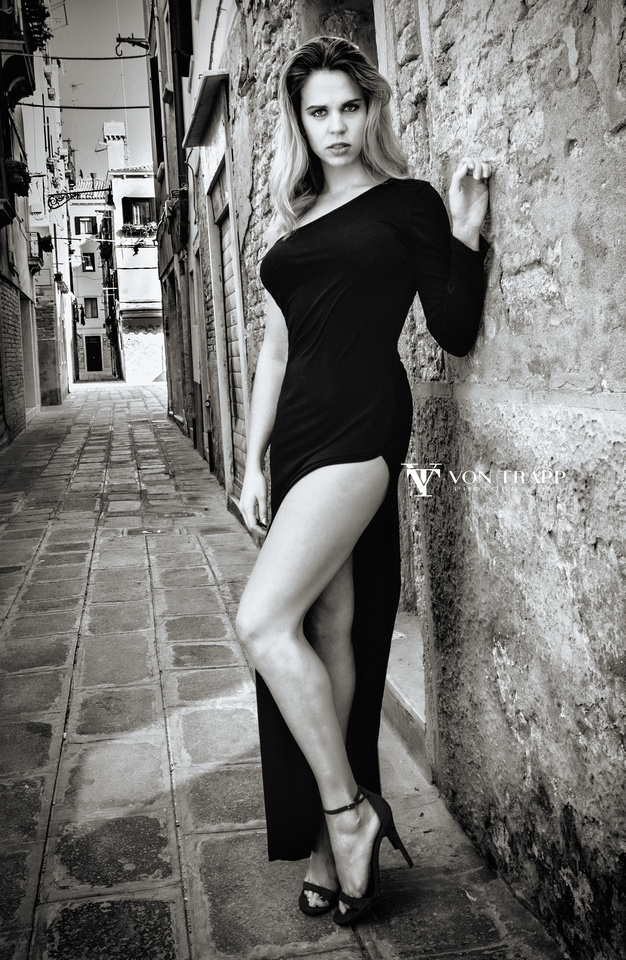 Photo of a sexy woman in a high slit dress in Venice Italy.
