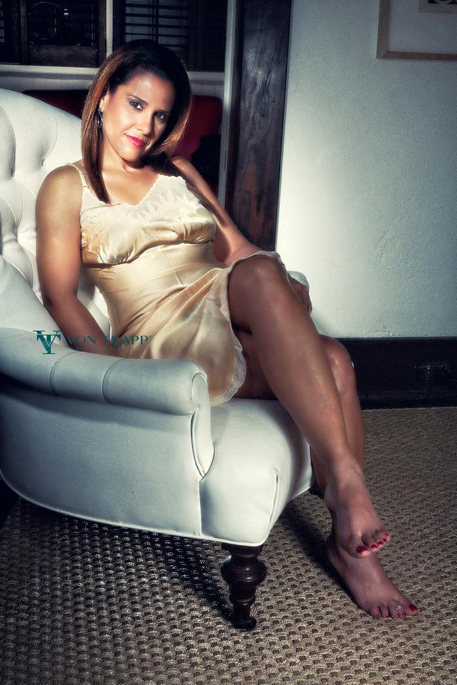 Sexy mature woman wearing a slip in a boudoir photo. San Antonio Boudoir Photography.