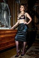 Fashion-Glamour photo of a hot busty woman in a sheer bra and pencil skirt in a Venetian palazzo.
