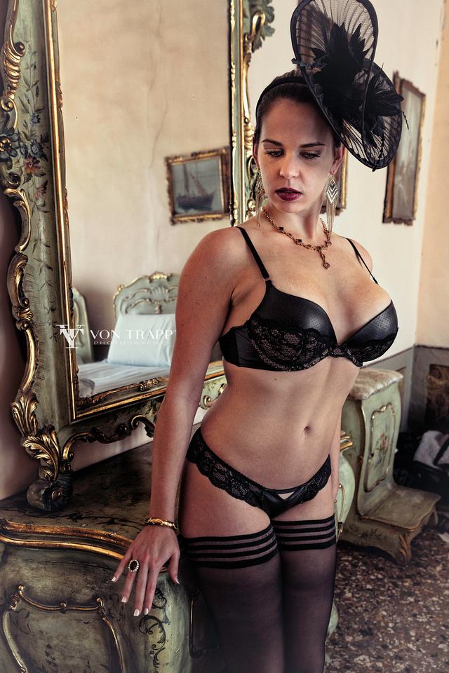 Boudoir Glamour photo of a busty woman in lingerie, taken in a Venetian palazzo.