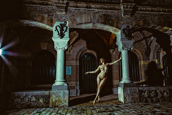 Art nude photo of a woman outdoors at nighttime in Naarden, Holland.