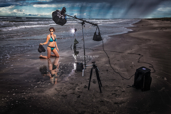 Behind the scenes photograph of a woman in a bikini on a Texas beach.