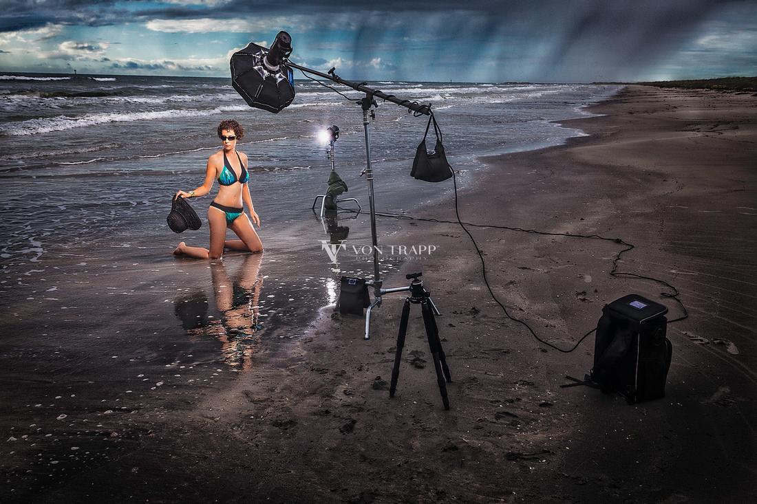 Behind the scenes photograph of a woman in a bikini on a Texas beach.