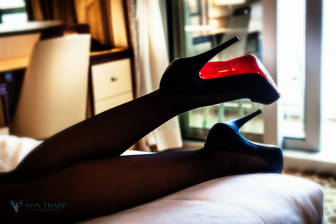 Boudoir Glamour photo of a woman's sexy legs in black stockings, and stilettoes.