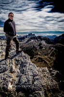 Photo of a man in the Italian Dolomites, standing at the edge of a cliff.