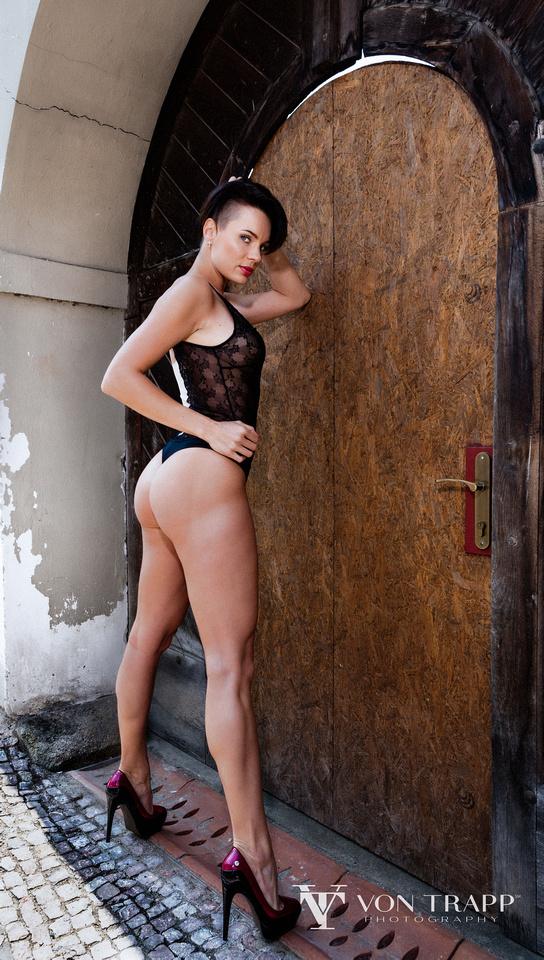 San Antonio Fashion Photographer a model wearing a thong bodysuit on the street of Prague. Texas Fashion, Glamour, Boudoir Photographer