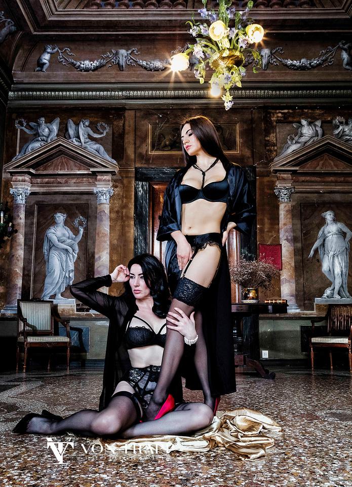 Fashion photo of two women wearing lingerie in a frescoed Venetian palazzo.
