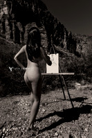 Fashion nude photo of a woman sketching at an artist's easel in Texas desert.