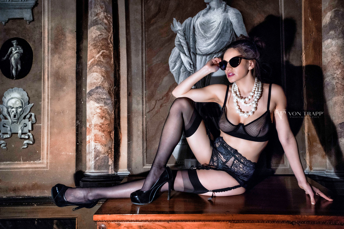 Fashion glamour image of a woman in a Venice palazzo wearing lingerie.